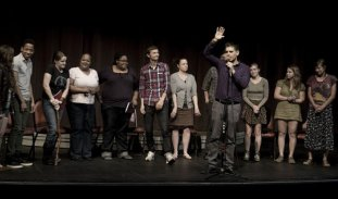 performers from the dialogue arts project onstage.