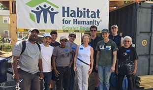 Group photo of participants in a Habitat for Humanity build.