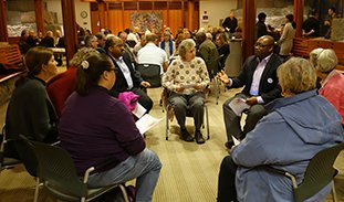 Participants in a talking circle in Trinity's Forum.