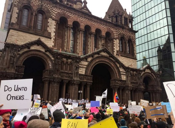 Protesters gather outside Trinity Church in Copley Square to support refugees and immigrants.