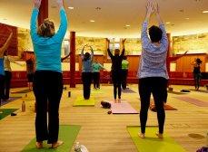 parishioners practice yoga in the Undercroft.