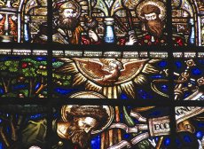 Detail of a stained glass window from Trinity with dove descending.