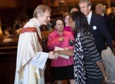 Sam shaking hands with parishioner