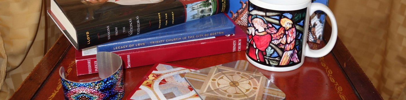 Items for sale in the Trinity shop:  mugs, books, coasters, and more.